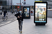 Public Health England NHS information advice boards in the City Centre as tier three / very high alert level of the Coronavirus tier system continues during the run up to Christmas on 14th December 2020 in Birmingham, United Kingdom. After 9 months of lockdown in various forms, people are used to navigating the rules of shopping safely as all non-essential shops try to increase their takings and onwards to the national economy.