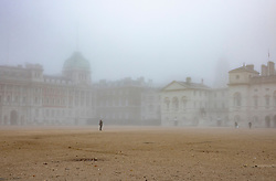 © Licensed to London News Pictures. 05/11/2020. London, UK. A visitor to a foggy Horse Guards Parade take a photo in central London on the first day of England's national lockdown. Photo credit: London News Pictures