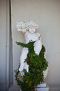 Statue with flowers at a historic home along the Battery in Charleston, SC.