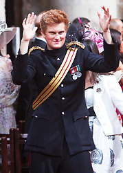STRICT EMBARGO TO 00:01 FRIDAY 15 APRIL 2011 © licensed to London News Pictures. LONDON, UK  12/04/11. HRH Prince Harry dances in the aisle. The filming of a new T-Mobile advert in which Kate Middleton and Prince William lookalikes pretend to get married at a mock royal wedding. The filming took place at St Bartholomew the Great Church in London. All the main royal family members and the Arch Bishop of Canterbury were played by actors. The actors danced down the aisle with moves choreographed by Louie Spence. Please see special instructions. Photo credit should read Cliff Hide/LNP.