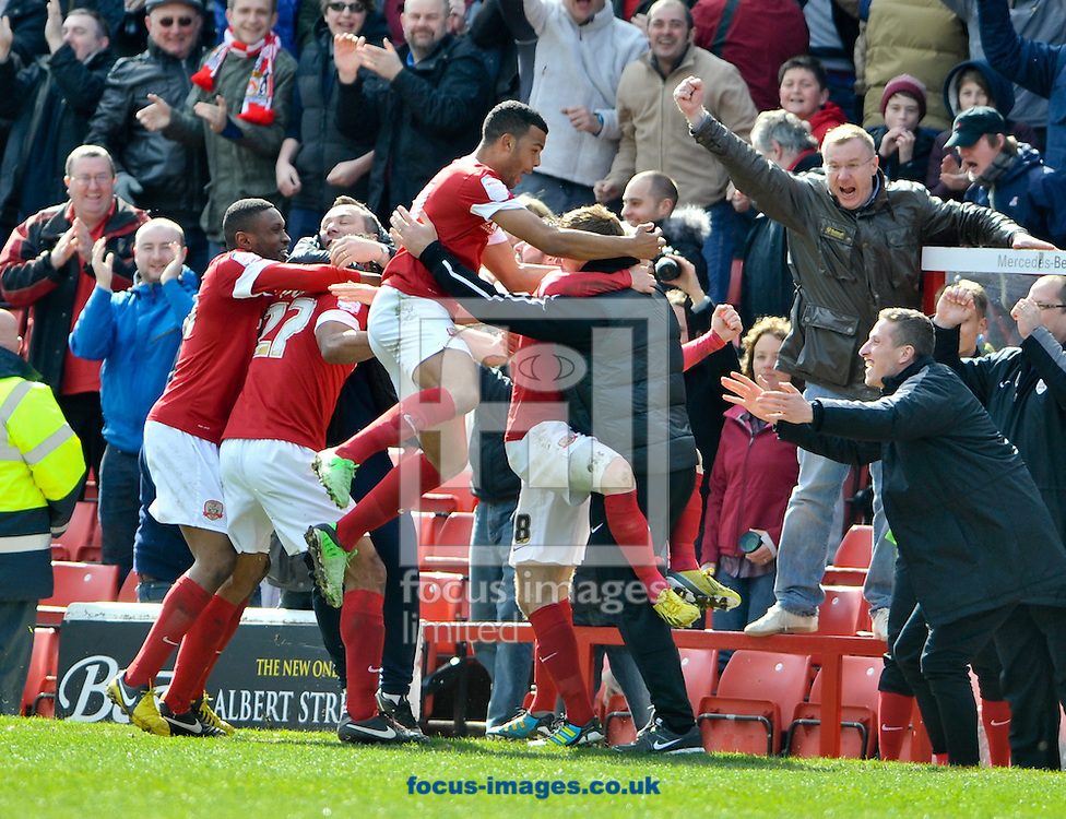 Picture by Richard Land/Focus Images Ltd +44 7713 507003.27/04/2013.Barnsley players celebrate Chris O'Grady goal with Manager David Flitcroft during the npower Championship match at Oakwell, Barnsley.