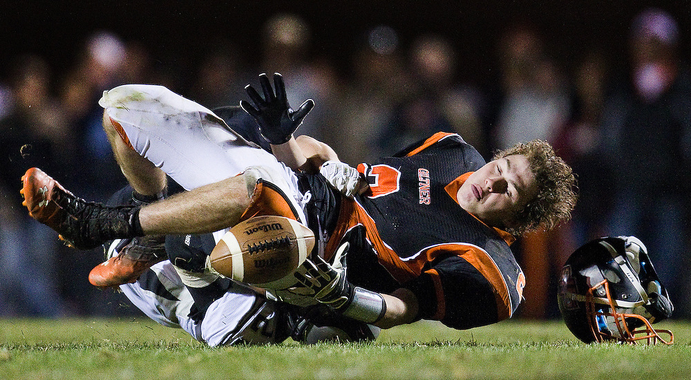 Giltner wide receiver Christian Leichty loses his helmet after Lawrence-Nelson defender Austin Mazour broke up the pass in the third quarter of Thursday's playoff game at Giltner High School. Giltner defeated Lawrence-Nelson 28-26. (Independent/Matt Dixon)