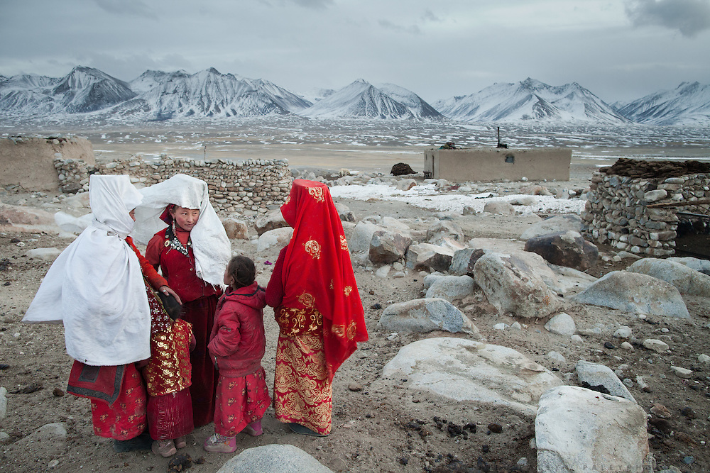 Taking a rare break in their day, women gossip at the Khan's camp. The origin of the word Kyrgyz is believed by scholars and Kyrgyz alike to derive from two words - kyrk (forty) kyz (maidens) - a reference to the mythical progenitors of the Kyrgyz people..At the Qyzyl Qorum camp. It is the camp of the now deceased Khan (Abdul Rashid Khan, died in December 2009), and headed by the self proclaimed young Haji Roshan Khan (his son). Opium addicted Haji Roshan was never officially stated Khan and is therefore not accepted as leader by the entire Kyrgyz community.