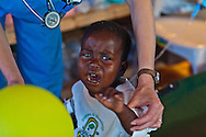 Nicolas Railleson being treated for cholera in Port-au-Prince at a Samaritan's Purse clinic. Samaritan's Purse, an NGO, openned a second cholera clinic in Cité Soleil on November 29th with 200 beds.