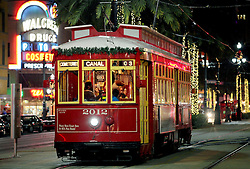 22 Nov 2011. New Orleans, Louisiana, USA.  <br /> Christmas lights on Canal Street as the street cars roll by disgorging tourists at the Bourbon and Royal Street stops.<br /> The lighting ceremony from the Astor Crowne Plaza.<br /> Photos; Charlie Varley