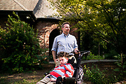 BIRMINGHAM, AL – AUGUST 26, 2018: Dr. Matthew Might prepares to take a walk with his son, Bertrand. CREDIT: Bob Miller for The New York Times