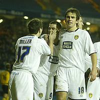 Photo: Aidan Ellis.<br /> Leeds United v Wigan Athletic. The FA Cup. 17/01/2006.<br /> Leeds Simon Walton and Liam Miller congratulate David Healy after he scored the second goal from the penalty spot