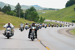 "Rich Robbins aka Buddha"" and Jon and Pinky Barwood lead the annual Michael Lichter - Sugar Bear Ride hosted by Jay Allen from the Easyriders Saloon during the Sturgis Black Hills Motorcycle Rally. SD, USA. Sunday, August 3, 2014.  Photography ©2014 Michael Lichter."