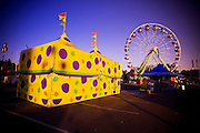 A tent and ferris wheel at the famous North Carolina State Fairgrounds.