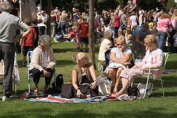 Women sitting in the park at fun day,