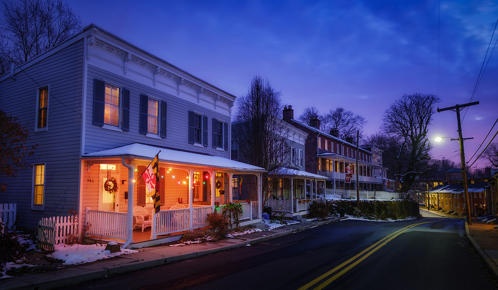 Oella, Maryland at dusk in winter. Christmas lights glow.