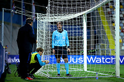 A goal net is fixed during the UEFA Nations League match at Stadion HNK Rijeka in Croatia.