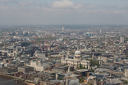 © Licensed to London News Pictures. 13/06/2016. LONDON, UK.  An aerial view of London showing St Paul's Cathedral during sunny spring weather today. Haze and pollution is seen hanging towards the horizon.  Photo credit: Vickie Flores/LNP