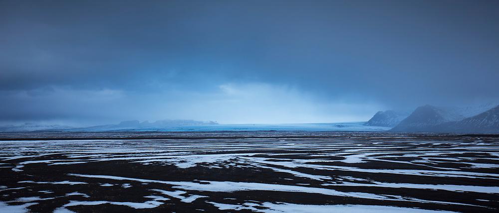 Melting snow on glacial alluvial plain by Skeidararjokull glacier in Vatnajokull National Park,  South Iceland