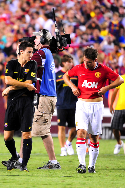 Michael Owen (Manchester United) swaps shirts with Andres Iniesta (FC Barcelona) after the match. - FC Barcelona vs. Manchester United - Pre-Season Friendly at Red Bull Arena, New York - 30/07/11 - Mandatory Credit: Pixel8 Photos/Jack Megaw - +44(0)7734 151429 - info@pixel8photos.com - NO UNPAID USE.