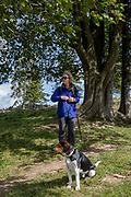 A lady walker and her dog, on 20th September 2019, Biala Woda, Jaworki, near Szczawnica, Malopolska, Poland.