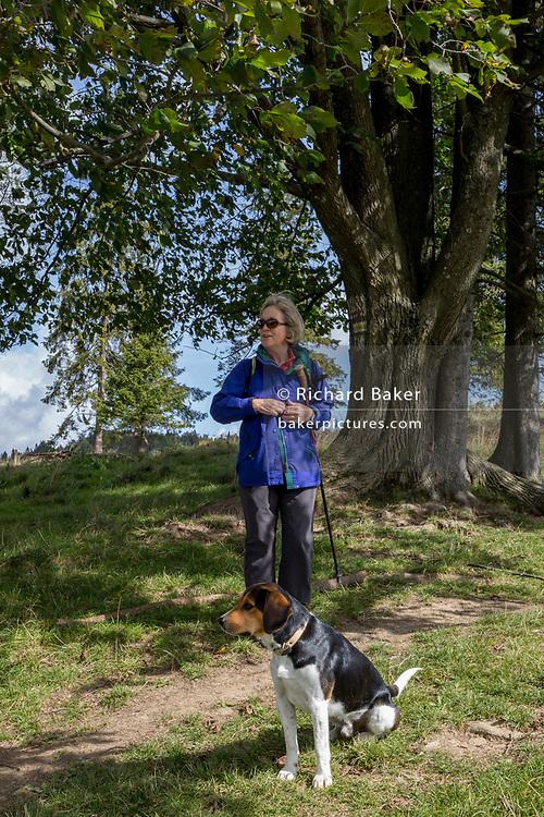 A lady walker and her dog, on 20th September 2019, Biala Woda, Jaworki, near Szczawnica, Malopolska, Poland.