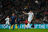 Michael Keane of England heads the ball clear during the International Friendly match between England and USA at Wembley Stadium, London, England on 15 November 2018.