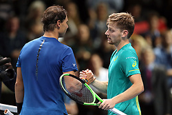 Belgium's David Goffin (right) after beating Spain's Rafael Nadal during day two of the NITTO ATP World Tour Finals at the O2 Arena, London.