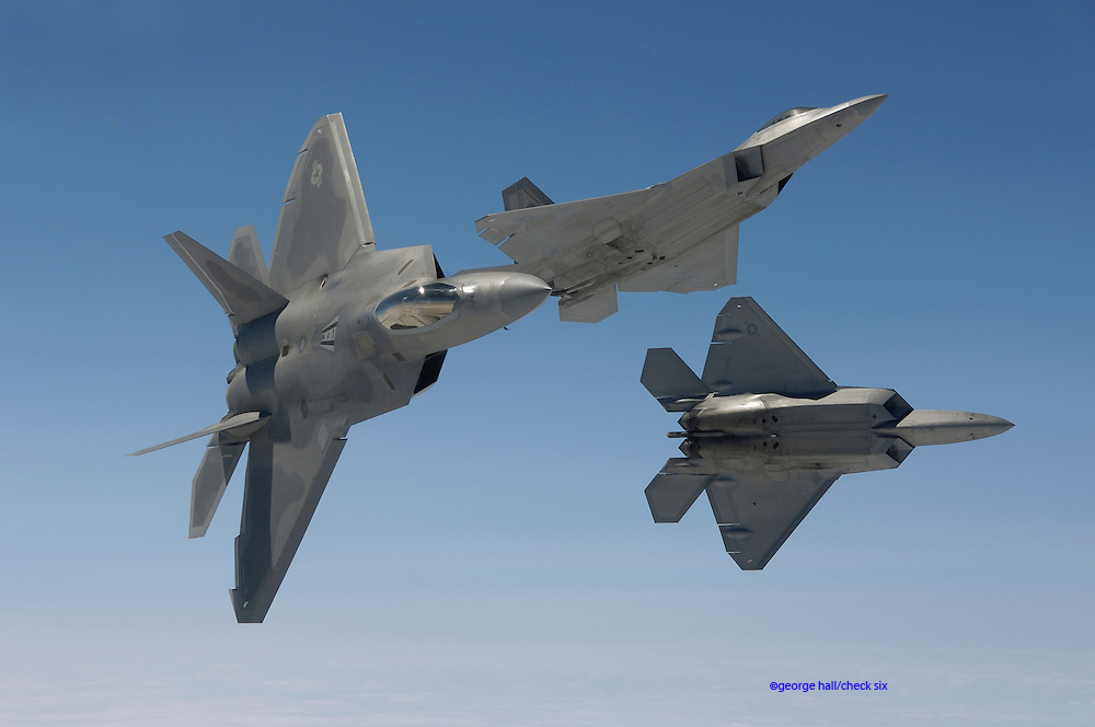 F-22As in acrobatic maneuvers