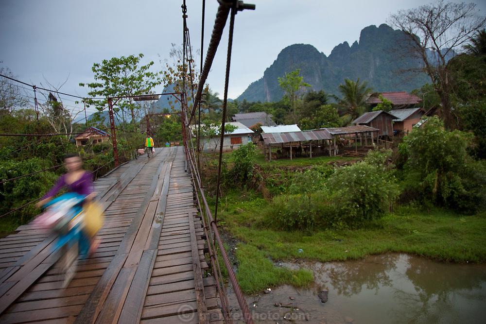 Vang Vieng, Laos. Nam Song River toll bridge.