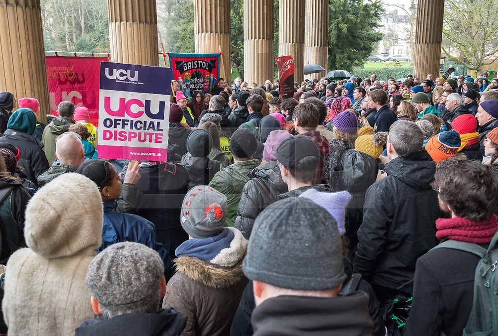 © Licensed to London News Pictures. 20/02/2020. Bristol, UK. University Strike across the UK; rally and march in the rain by members of the University and College Union (UCU) at the University of Bristol. Strikers gather outside the university's Victoria Rooms to march down Bristol's Park Street past the university's Wills Memorial tower. There are two disputes involving UCU members in higher education in the UK. One is about changes to the Universities Superannuation Scheme (USS) and the other is about pay and working conditions including equality, casualisation and workloads. UCU members in 52 institutions in the UK have voted to take strike action and action short of a strike (ASOS) about USS. Members in 70 institutions have voted to take strike action and action short of strike about pay and working conditions. In total, 74 institutions are affected. The strike is taking place over four weeks till March with strike days increasing every week. Union members will also begin 'action short of a strike' which involves things like working strictly to contract, not covering for absent colleagues and refusing to reschedule lectures lost to strike action. Photo credit: Simon Chapman/LNP.