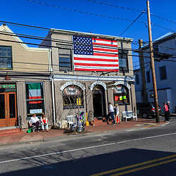 St. Michaels, MD, USA - March 30, 2013: A large US Flag is displayed on a saloon wall in St Michaels MD
