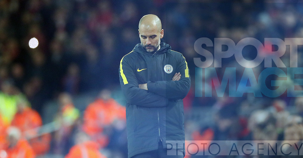 Manchester City Manager Pep Guardiola appears behind smoke from a flare that was thrown during the English Premier League match at Anfield Stadium, Liverpool. Picture date: December 31st, 2016. Photo credit should read: Lynne Cameron/Sportimage