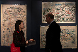 """© Licensed to London News Pictures. 03/11/2016. London, UK. Rare maps of ancient China are shown at the preview of Chinese artworks entitled """"Treasures Of The Song & Qing Dynasties"""" to be auctioned at Sotheby's in November.   Photo credit : Stephen Chung/LNP"""