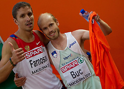 Andrey Farnosov of Russia and Bostjan Buc of Slovenia after competing in the Mens 3000m Steeplechase Final during day six of the 20th European Athletics Championships at the Olympic Stadium on August 1, 2010 in Barcelona, Spain. (Photo by Vid Ponikvar / Sportida)