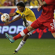 Juan Cuadrado, Colombia, shoots during the Colombia Vs Canada friendly international football match at Red Bull Arena, Harrison, New Jersey. USA. 14th October 2014. Photo Tim Clayton