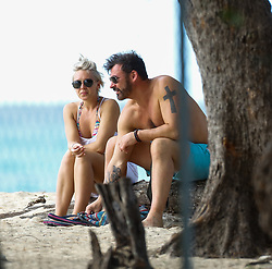 EXCLUSIVE: Former boxer Joe Calzaghe and girlfriend Lucy Griffiths go for a stroll on the beach while on holiday in Barbados. Lucy seems to be wearing an engagement ring. 01 Feb 2018 Pictured: Joe Calzaghe, Lucy Griffiths. Photo credit: Queensofthenorth/MEGA TheMegaAgency.com +1 888 505 6342