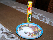 """A shocked stepmother was horrified to find a child's tube of sweets HALF FULL of sugar.<br /> <br /> Kelly Robertson, like many others, had filled her stepdaughters' Christmas stockings with sweet treats and chocolates. When a tube of Jelly Tots was opened, she was impressed to find the pack brimming over with the sugary sweets. However, things turned sour when a few sweets had been eaten…leaving behind a pile of sugar.<br /> Mrs Robertson – stepmum to Ellie, 14, and Ava, 11, and from Chelmsford, Essex – said: """"We always get quite cross when packs of sweets or crisps are half empty when you open them; it seems such a rip-off. So, when the Jelly Tots tube appeared to be full to the top with sweets, I was really pleasantly surprised.<br /> """"But, when I saw the tube after a few had been eaten, all I could see inside was sugar. It seemed quite odd, so I was compelled to empty the rest of the tube out onto a plate. I'm not usually the type to get up in arms about this sort of thing, but I was shocked to see more and more sugar pouring out – there must have been as much sugar as there was sweets!<br /> """"Luckily, our girls are old enough to realise that isn't normal. But, I remember when I was a child loving the sugar in a Jelly Tots pack, so I'm sure if the girls were younger they may have simply enjoyed eating their way through the sugary pack without realising what they were doing.""""<br /> The Rowntree's social media pages have been inundated with photos and complaints from parents finding similar unacceptable levels of sugar in Jelly Tots tubes.<br /> While one Rowntree's spokesman on Twitter responded with a lighthearted """"Our tubes do contain sugar to keep them in tip top condition and ready for enjoyment!"""", others have urged customers to get in touch and said """"there does seem a little more than usual"""" in response to photos of sugar-filled tubes.<br /> NHS chief executive Simon Stevens recently hit out at the amount of sugar children are eating and drinking today, warn"""