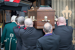 © Licensed to London News Pictures . 20/09/2014 . Manchester , UK . Pallbearers carry the coffin in to the cathedral . Arrivals at the funeral of Heywood and Middleton MP Jim Dobbin at Salford Cathedral today (Saturday 20th September 2014) . Photo credit : Joel Goodman/LNP
