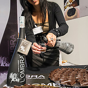 A woman pours some traditional liqueur based on Liquorice and chocolate  at the Biennale del Gusto. The Biennale del Gusto is an exhibition held over four days, dedicated to traditional food and drinks from all regions of Italy.