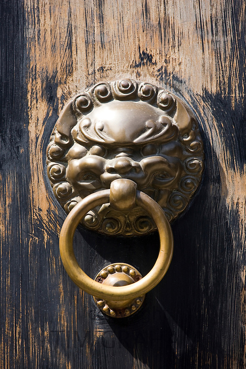 Lion-head knocker on door in the Yu Gardens, Shanghai, China