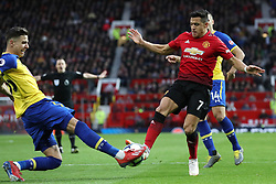 Southampton's Jan Bednarek (left) challenges Manchester United's Alexis Sanchez during the Premier League match at Old Trafford, Manchester.