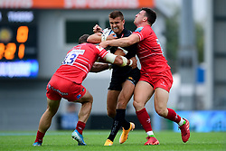 Henry Slade of Exeter Chiefs is tackled by Jaco Taute of Leicester Tigers and Matt Scott of Leicester Tigers - Mandatory by-line: Ryan Hiscott/JMP - 15/08/2020 - RUGBY - Sandy Park - Exeter, England - Exeter Chiefs v Leicester Tigers - Gallagher Premiership Rugby