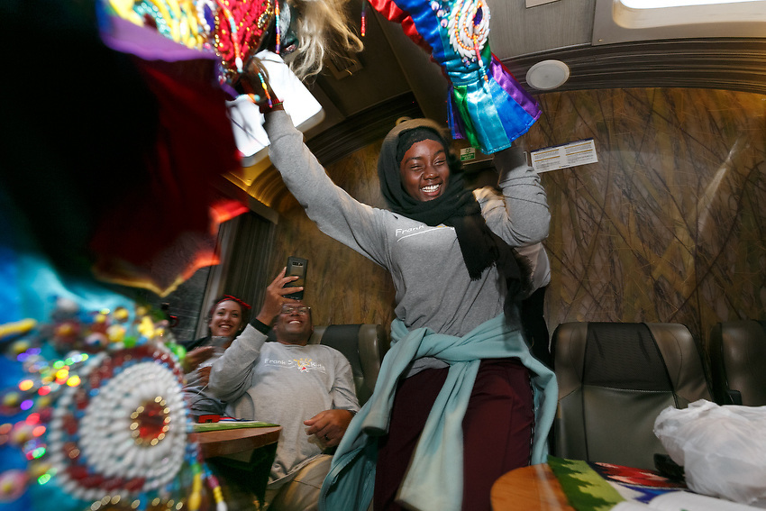 During the train ride back to Cusco, Jamilah Wells, 13, has fun with a Peruvian Saqra dancer who goes up and down the aisles looking for people to dance with.