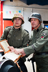 """Father and Son Reenactors Adam and Steven Torincsi portray members of the German Hungaria Division from late 1944/45 during the Sheffield Fire and Police Museums 1940s Weekend. Dad Steven explained """"Torincsi is a Hungarian name which is one of the reasons we chose to Portray the Hungaria Division""""<br /> <br /> 1 June 2013<br /> Image © Paul David Drabble<br /> www.pauldaviddrabble.co.uk"""