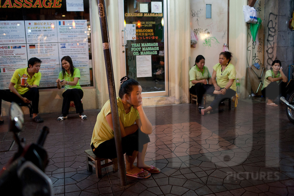 Staff of a Thai massage shop are waiting outside for clients, Bangkok, Thailand, Southeast Asia