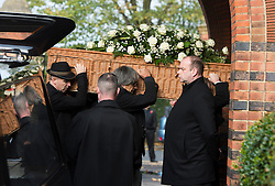 © London News Pictures. 05/11/2014. MALCOM BRUCE, son of Jack Bruce (far left) carrying the coffin in to the crematorium. The funeral Jack Bruce at Golders Green Crematorium in North London. Jack Bruce was the lead singer and bass player for British Rock band Creme, alongside Eric Clapton and Ginger Baker. Creme sold over 15 million albums worldwide and were widely considered to be the worlds first successful supergroup. Photo credit : Ben Cawthra/LNP