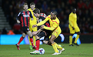 AFC Bournemouth midfielder Dan Gosling and Liverpool striker Raheem Sterling during the Capital One Cup match between Bournemouth and Liverpool at the Goldsands Stadium, Bournemouth, England on 17 December 2014.