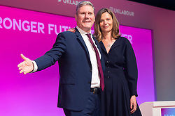 © Licensed to London News Pictures. 29/09/2021. Brighton, UK. Labour Party leader Keir Starmer with his wife Victoria Starmer on. stage after he makes a key note speech at the Labour Party Annual Conference in Brighton. Photo credit: London News Pictures