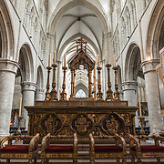 The back of the altar at the Cathedral of St. Michael and St. Gudula (in French, Co-Cathédrale collégiale des Ss-Michel et Gudule). A church was founded on this site in the 11th century but the current building dates to the 13th to 15th centuries. The Roman Catholic cathedral is the venue for many state functions such as coronations, royal weddings, and state funerals. It has two patron saints, St Michael and St Gudula, both of whom are also the patron saints of Brussels.