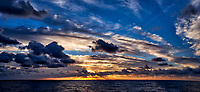 Sunrise, crepuscular rays, and clouds over the Pacific Ocean from the aft deck of the MV World Odyssey. Composite of 2 images taken with a  Fuji X-T1 camera and 23 mm f/1.4 lens (ISO 200, 23 mm, f/11, 1/125 sec). Raw images processed with Capture One Pro and AutoPano Giga Pro.