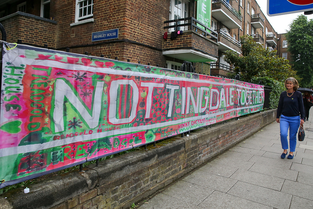 © Licensed to London News Pictures. 14/06/2019. London, UK. A woman walks past a large message left on railings to commemorate the second anniversary of the Grenfell Tower fire service. On 14 June 2017, just before 1:00am a fire broke out in the kitchen of the fourth floor flat at the 24-storey residential tower block in North Kensington, West London, which took the lives of 72 people. More than 70 others were injured and 223 people escaped. Photo credit: Dinendra Haria/LNP