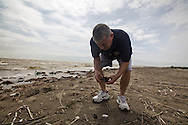 April 9, 2015, Almost five years after the BP oil spill,  Dean Blanchard owner of Dean Blanchard Seafood, holds up a BP tar ball up on East Grande Terre island, a barrier island in Plaquemines Parish that was hit hard by the BP oil spill in 2010.