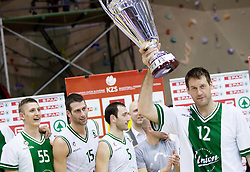 Goran Jagodnik and other players of Olimpija celebrate after winning the basketball match between KK Union Olimpija Ljubljana and KK Krka Novo mesto of finals of 11th Slovenian Spar Cup 2012, on February 19, 2012 in Sports hall Brezice,  Brezice, Slovenia. Union Olimpija defeated Krka 68-63 and became Slovenian Cup Champion 2012. (Photo By Vid Ponikvar / Sportida.com)