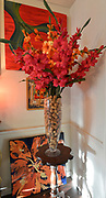 """Wine and champagne corks inside a glass vase holding her favorite flowers, gladiolus, in the dining room. Photo taken on January 8, 2019 for """"At Home"""" feature on Sandy Stolberg, who uses dollar store finds as part of the decorations in her Belleville, IL condo.<br /> Photo by Tim Vizer"""
